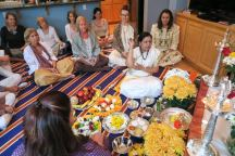 Sharada Ma offering flowers to Shiva with Satsang puja attendees.
